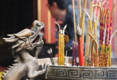 775590-incense-burning-at-a-temple-during-chinese-new-year-celebrations-in-qingdao-china