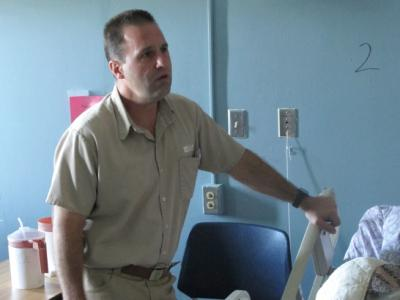 Inmate Scott Abram sings to a fellow inmate who is dying and is spending his last days in a prison hospice program, on Friday, Sept. 11, 2015 in Columbus, Ohio. Abram, serving 15 years to life for murder, is a counselor trained in a national ministry program who sees his volunteer work as part of his own growth. (AP Photo/Andrew Welsh-Huggins)