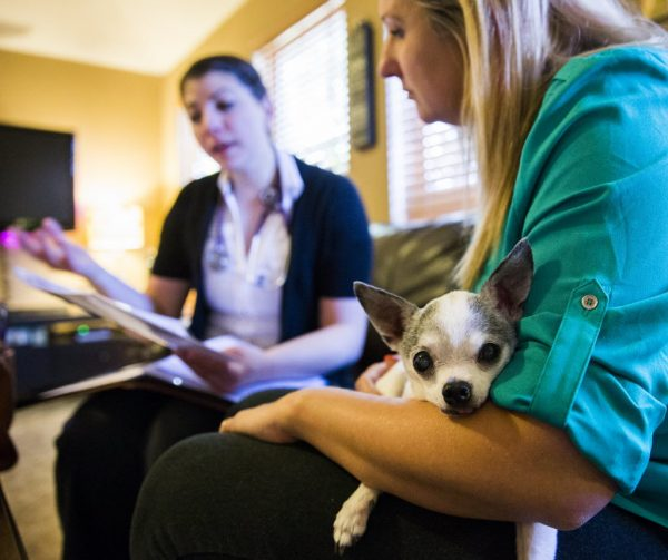 Amber Weiss talks with veterinarian Joanna Harchut about hospice care for her Chihuahua Boston.