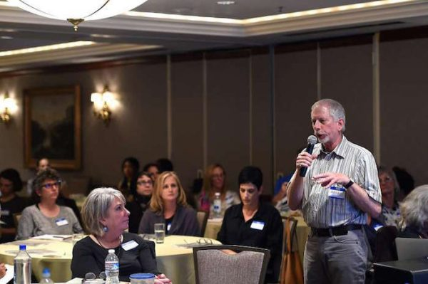 Henry Fersko-Weiss, co-founder and president of the International End of Life Doula Association, conducts a session at the association's training at the Omni Hotel in San Francisco.