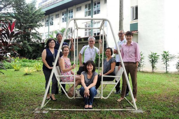 Volunteers (from left) Jeanette Wee, Francis Lim, Jaki Fisher, Tio Guat Kuan (sitting), Ng Seng Chuan, Angela Sho, Paul Koh and Ashleigh Quek provide a comforting presence to patients with no family or close friends in their final hours at Assisi Hospice.