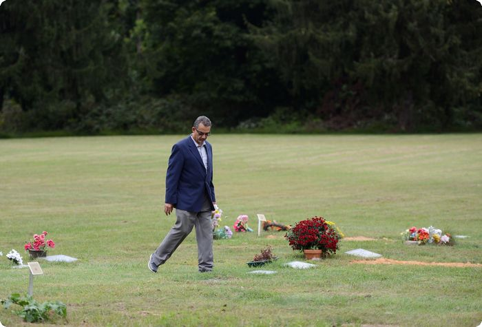 "Elsayed ""Steve"" Elmarzouky walks through the area dedicated to Muslims in Laureldale Cemetery."