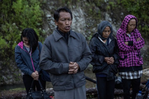 Villagers pray before they perform the Ma'Nene ritual in Barrupu village, Toraja, South Sulawesi, Indonesia.