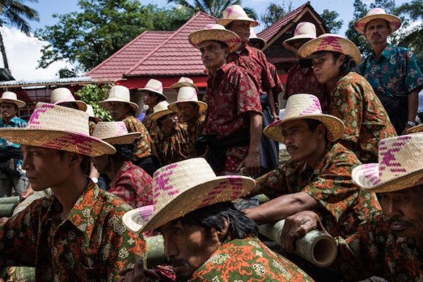 Men gather to perform a Ma'Badong dance during the Rambu Solo of V.T. Sarangullo.