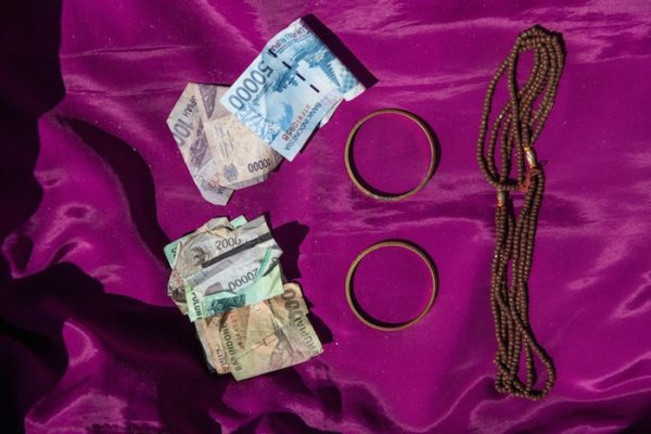 Personal belongings of Marta Ratte Limbong inside the coffin including money, a necklace and two gold bracelets.