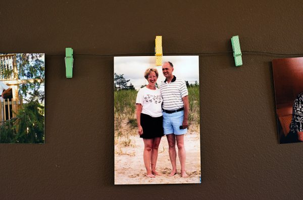 A photograph of Shelley Duffin's mother and father hangs in her home. Shelley and her Father reflect on her mother's passing through assisted suicide which occured in Switzerland due to narrowly being denied the right in Canada.