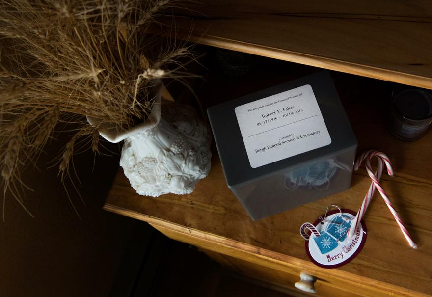 """A nondescript box containing the ashes of Bob Faller sits atop a hutch he built by hand in his earlier years. """"There's pieces of furniture he built all over the country,"""" Jane said."""