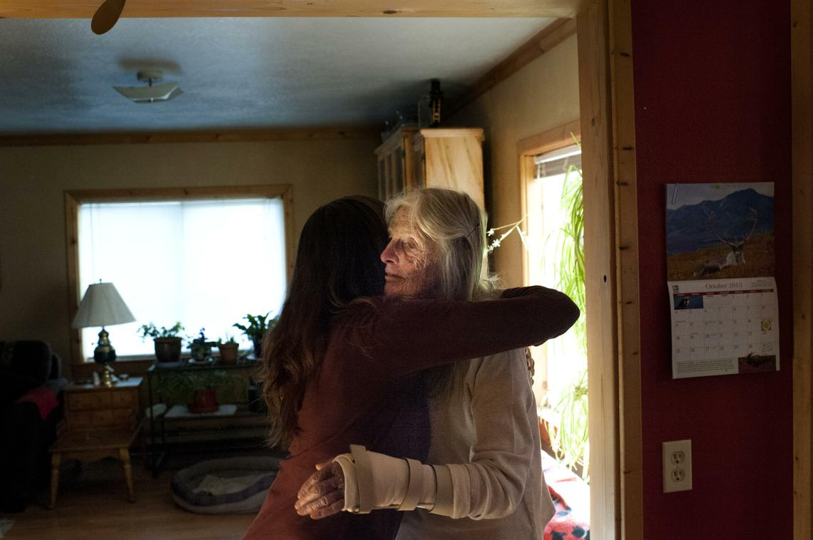 Jane Faller is embraced by her longtime friend